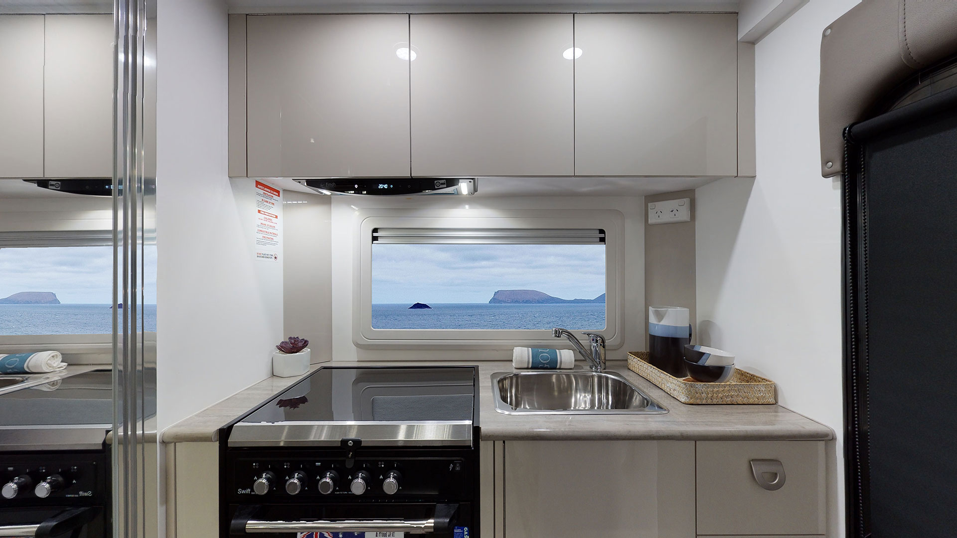 Cook up a storm with proper stove & grill, sink with flick mixer, and rangehood. Gloss finish on cabinets.