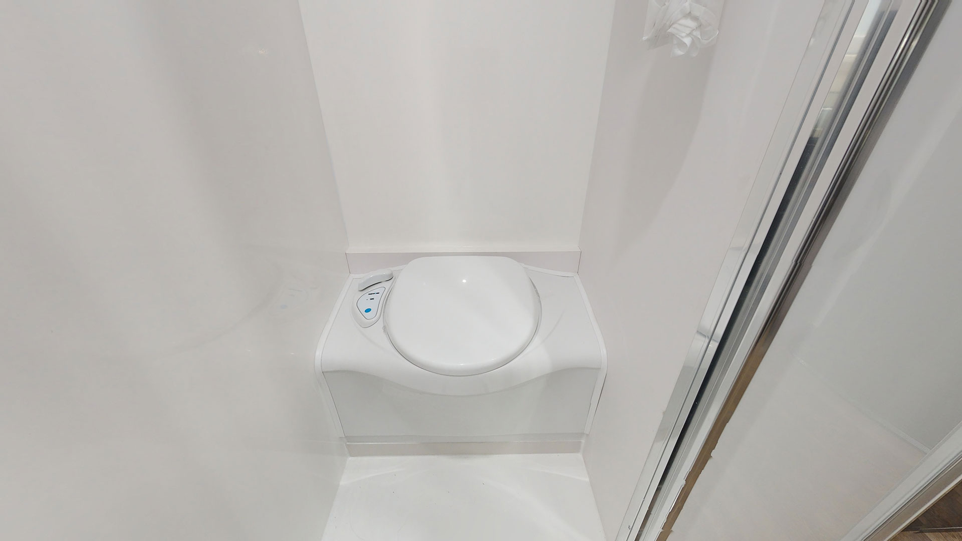 The Hurricanes' en-suite has a shower, a toilet, a vanity basin, and a shaving cabinet. Awesome set up!